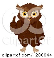 Clipart Of A Happy Brown Owl Giving A Thumb Up Royalty Free Vector Illustration by BNP Design Studio