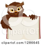 Clipart Of A Brown Owl Holding Up An Open Book And Pointing To Its Blank Pages Royalty Free Vector Illustration by BNP Design Studio