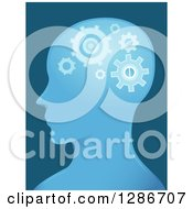 Clipart Of A Blue Male Head In Profile With Cog Wheels Working In His Brain Royalty Free Vector Illustration