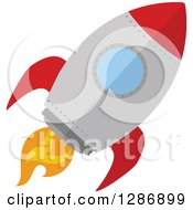 Clipart Of A Modern Flat Design Of A Red And Metal Rocket Royalty Free Vector Illustration