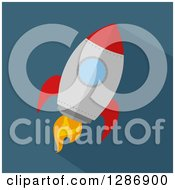 Clipart Of A Modern Flat Design Of Ared And Metal Rocket And Shadow Over Blue Royalty Free Vector Illustration