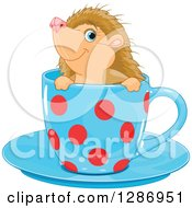 Clipart Of A Cute Blue Eyed Hedgehog In A Blue And Red Polka Dot Tea Cup Royalty Free Vector Illustration
