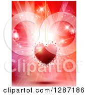 Clipart Of A Suspended Red Heart Pendant Over Flares And Lights Royalty Free Vector Illustration