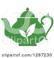 Clipart Of A Silhouetted Green Tea Pot With White Leaves Royalty Free Vector Illustration