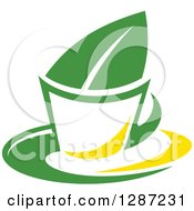 Clipart Of A Green And Yellow Tea Cup With A Leaf 4 Royalty Free Vector Illustration