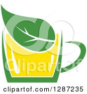 Clipart Of A Green And Yellow Tea Cup With A Leaf Royalty Free Vector Illustration