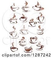 Clipart Of Two Toned Brown And White Steamy Coffee Cups And Saucers Royalty Free Vector Illustration
