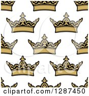 Clipart Of A Seamless Patterned Background Of Ornate Gold Crowns On White Royalty Free Vector Illustration