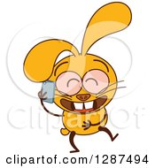 Clipart Of A Cartoon Yellow Rabbit Giggling And Talking On A Cell Phone Royalty Free Vector Illustration