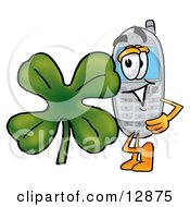 Wireless Cellular Telephone Mascot Cartoon Character With A Green Four Leaf Clover On St Paddys Or St Patricks Day