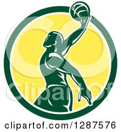 Clipart Of A Retro Silhouetted Green Basketball Player Doing A Layup In A Green White And Yellow Circle Royalty Free Vector Illustration
