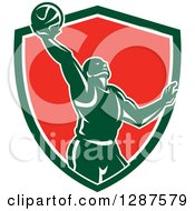 Clipart Of A Retro Silhouetted Basketball Player Doing A Layup In A Green White And Red Shield Royalty Free Vector Illustration by patrimonio