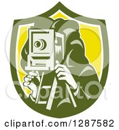 Clipart Of A Retro Male Photographer Using A Box Camera In A Green White And Yellow Shield Royalty Free Vector Illustration