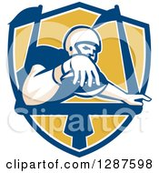 Clipart Of A Retro American Football Player Scoring A Touchdown In A Blue White And Yellow Shield Royalty Free Vector Illustration