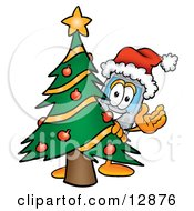 Clipart Picture Of A Wireless Cellular Telephone Mascot Cartoon Character Waving And Standing By A Decorated Christmas Tree by Toons4Biz