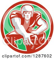 Clipart Of A Retro Male American Football Player In Snap Position In A Red White And Green Circle Royalty Free Vector Illustration