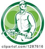 Clipart Of A Retro Gas Station Attendant Jockey Holding A Nozzle In A Green And White Circle Royalty Free Vector Illustration