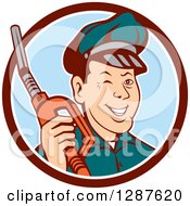 Clipart Of A Retro Cartoon Winking Gas Station Attendant Jockey Holding A Nozzle In A Brown White And Blue Circle Royalty Free Vector Illustration