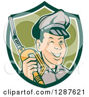 Clipart Of A Retro Cartoon Winking Gas Station Attendant Jockey Holding A Nozzle In A Green And White Shield Royalty Free Vector Illustration