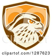 Clipart Of A Retro Peregrine Falcon Head In A Tan Brown White And Orange Shield Royalty Free Vector Illustration by patrimonio