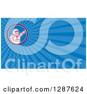 Clipart Of A Retro Cartoon Male Astronaut Pointing And Blue Rays Background Or Business Card Design Royalty Free Illustration by patrimonio