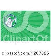 Clipart Of A Retro Cartoon Male Astronaut Pointing And Green Rays Background Or Business Card Design Royalty Free Illustration by patrimonio