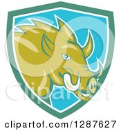 Clipart Of A Cartoon Wild Razorback Boar Pig In A Turquoise White And Blue Shield Royalty Free Vector Illustration