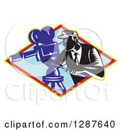 Clipart Of A Retro Woodcut Male Cameraman Working In A Yellow Red And Blue Diamond Royalty Free Vector Illustration