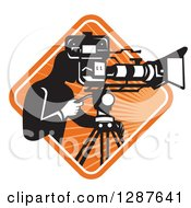 Clipart Of A Retro Black And White Male Cameraman Working In A White And Orange Sunburst Diamond Royalty Free Vector Illustration