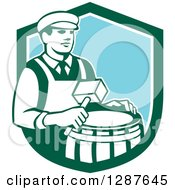 Clipart Of A Retro Male Cooper Barrel Maker Holding A Mallet Over A Drum In A Green White And Blue Shield Royalty Free Vector Illustration