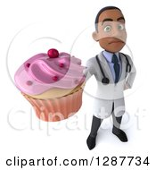 3d Unhappy Young Black Male Nutritionist Doctor Holding Up A Pink Frosted Cupcake