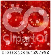 Clipart Of A Background Of Red Flares And Valentine Heart Bokeh Royalty Free Vector Illustration by KJ Pargeter