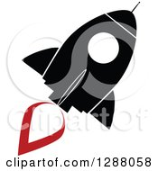 Clipart Of A Modern Flat Design Of A Black And White Rocket With A Red Trail Royalty Free Vector Illustration