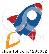 Clipart Of A Modern Flat Design Of A Blue Red And White Rocket With An Orange Trail Royalty Free Vector Illustration