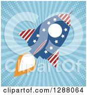 Clipart Of A Modern Flat Design Of An American Rocket Over Blue Grungy Rays And Halftone Royalty Free Vector Illustration