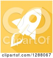 Clipart Of A Modern Flat Design Of A White Rocket With A Shadow On Yellow Royalty Free Vector Illustration