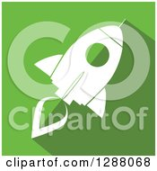 Clipart Of A Modern Flat Design Of A White Rocket With A Shadow On Green Royalty Free Vector Illustration