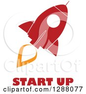 Clipart Of A Modern Flat Design Of A Red And White Rocket With An Orange Trail And Start Up Text Royalty Free Vector Illustration