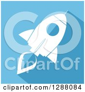 Clipart Of A Modern Flat Design Of A White Rocket With A Shadow On Blue Royalty Free Vector Illustration