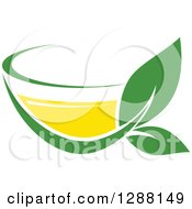 Clipart Of A Green And Yellow Tea Cup With Leaves 5 Royalty Free Vector Illustration