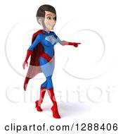 Clipart Of A 3d Young Brunette White Female Super Hero In A Blue And Red Suit Walking And Pointing To The Right Royalty Free Illustration