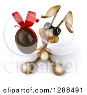 Clipart Of A 3d Brown Bunny Rabbit Wearing Sunglasses And Holding Up A Chocolate Easter Egg Royalty Free Illustration