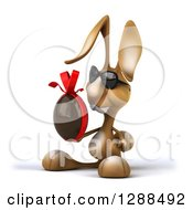 Clipart Of A 3d Brown Bunny Rabbit Wearing Sunglasses Facing Left And Holding A Chocolate Easter Egg Royalty Free Illustration