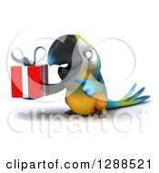Clipart Of A 3d Blue And Yellow Macaw Parrot Holding And Pointing To A Gift Royalty Free Illustration by Julos