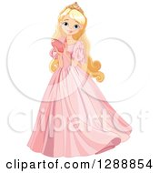 Beautiful Blond Blue Eyed Caucasian Princess Holding A Heart And Wearing A Pink Dress
