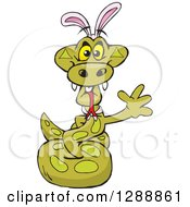 Clipart Of A Cartoon Happy Python Snake Wearing A Christmas Sant Hat And Waving Royalty Free Vector Illustration