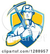 Clipart Of A Retro Male Coal Miner Holding A Pickaxe In A Yellow Blue And White Shield Royalty Free Vector Illustration by patrimonio