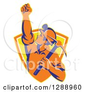 Clipart Of A Retro Male Coal Miner Holding Up A Fist And A Pickaxe In A Yellow And Orange Shield Royalty Free Vector Illustration