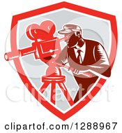 Clipart Of A Retro Woodcut Male Cameraman Working In A Red White And Gray Shield Royalty Free Vector Illustration