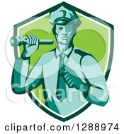 Clipart Of A Retro Male Police Officer Shining A Flashlight And Pointing In A Navy Blue White And Green Shield Royalty Free Vector Illustration